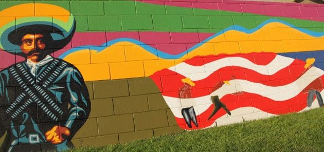 Dolore Huerta Foundation Youth Group are working hard to finish this mural/ Photo by BERENICE SANCHEZ/South Kern Sol